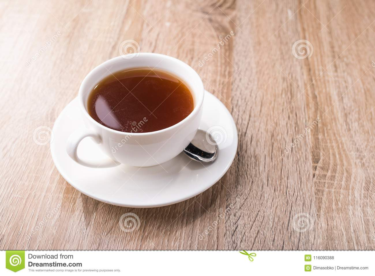 Hot tea cup with spoon