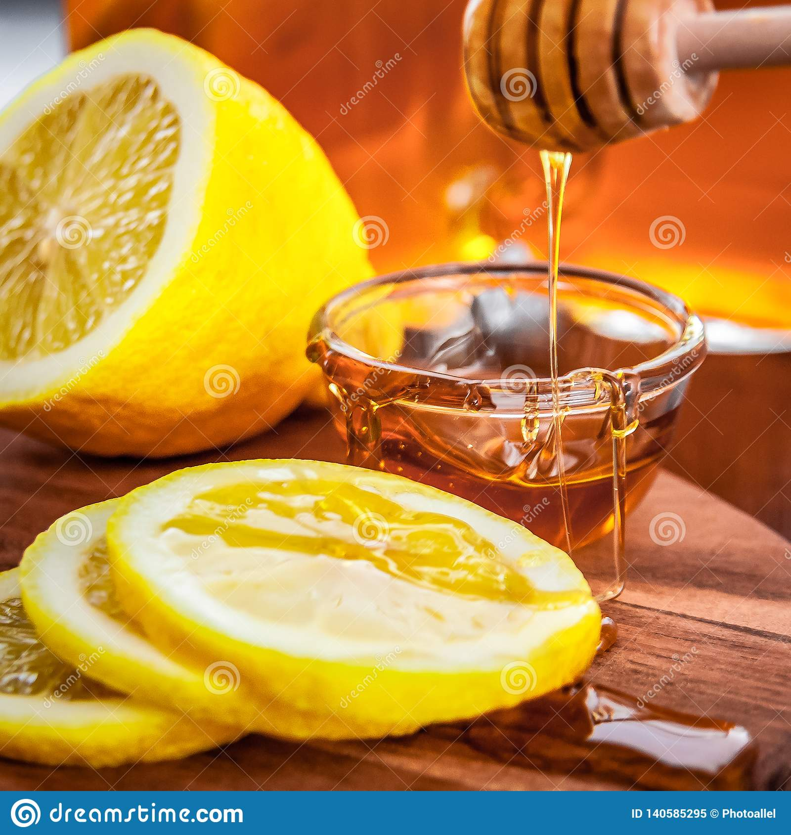 Hot tea with lemon and natural honey, good treat to have vitamins and strong immunity.