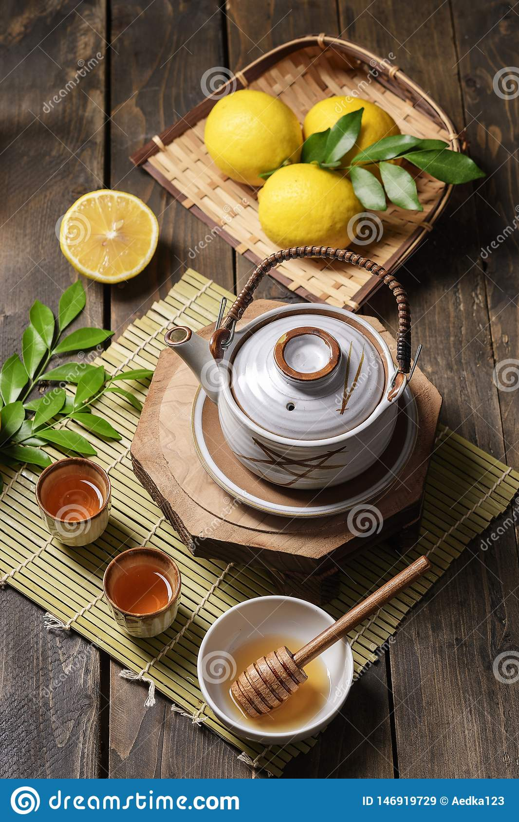 Hot tea with lemon and natural honey, good treat to have vitamins and strong immunity