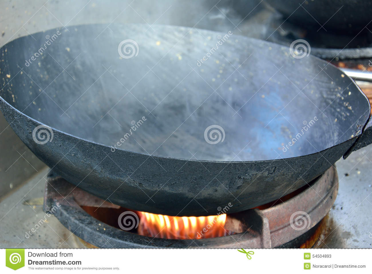 Hot Wok on a stove stock image. Image of restaurant, object - 54504893
