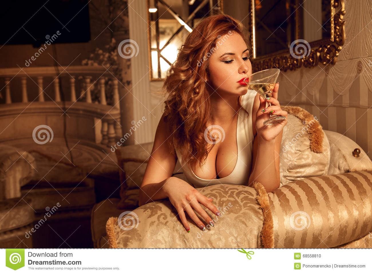 Hot Young Lady With Big Boobs Drinks Martini Stock Photo -3584