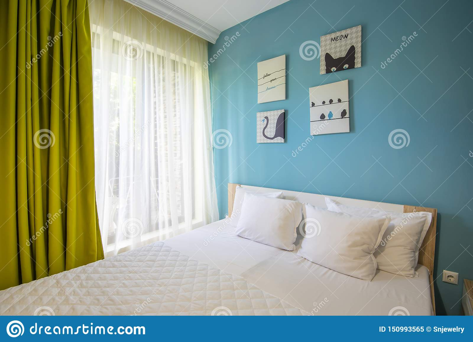 Hotel Bedroom With Blue Walls White Sheers Pillowcases And Sheets Green Curtains Stock Image Image Of Indoors Beautiful 150993565