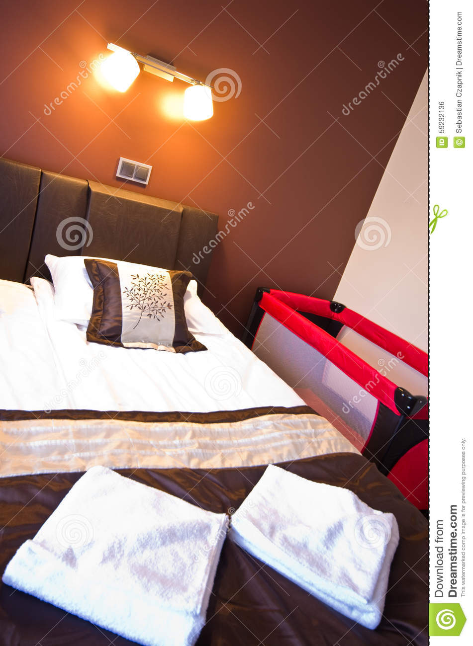 Motel Room Interiors: Hotel Bedroom With Playpen Stock Photo. Image Of Concept