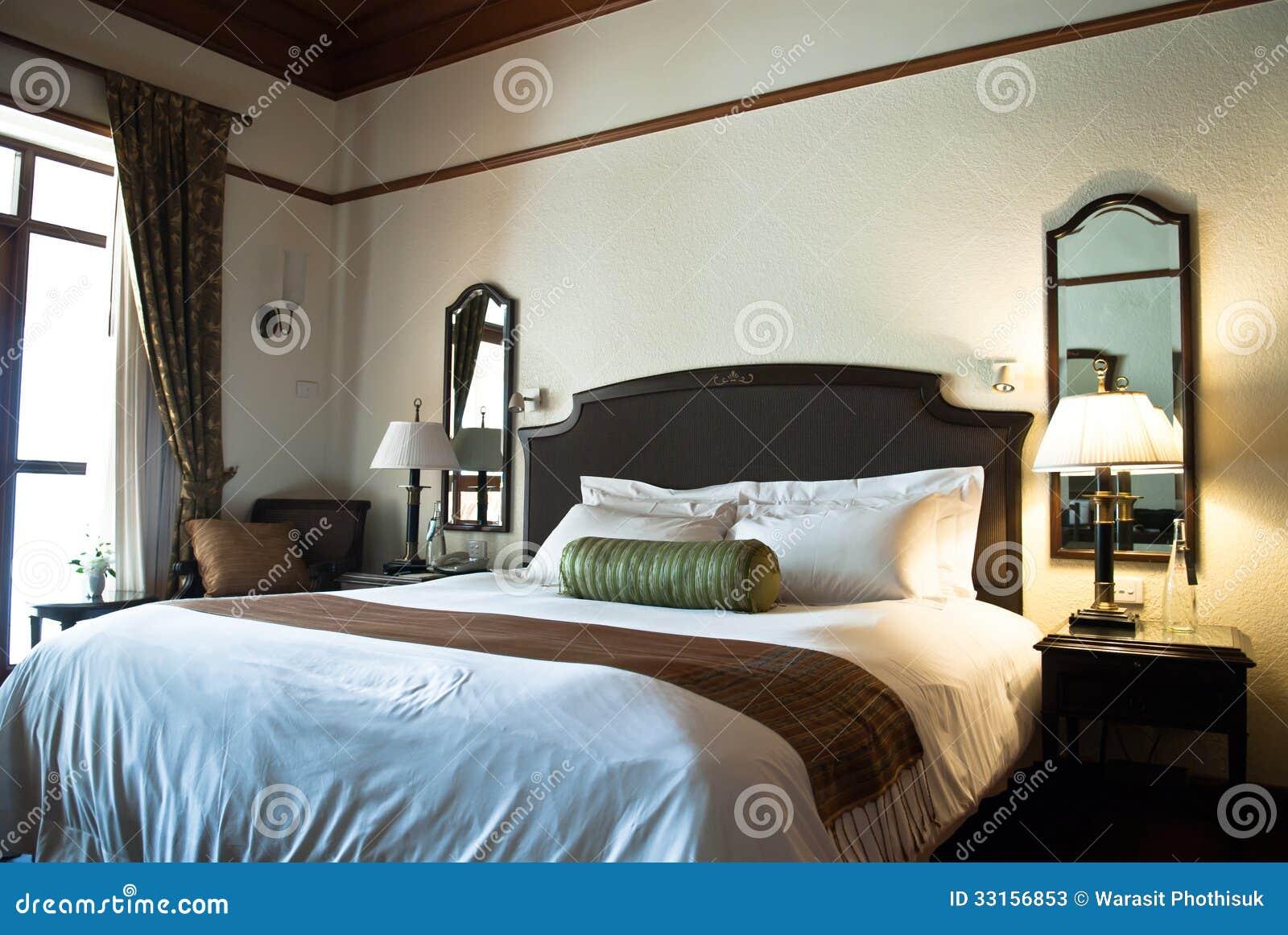 Hotel bedroom stock image. Image of comfortable, bedding ...