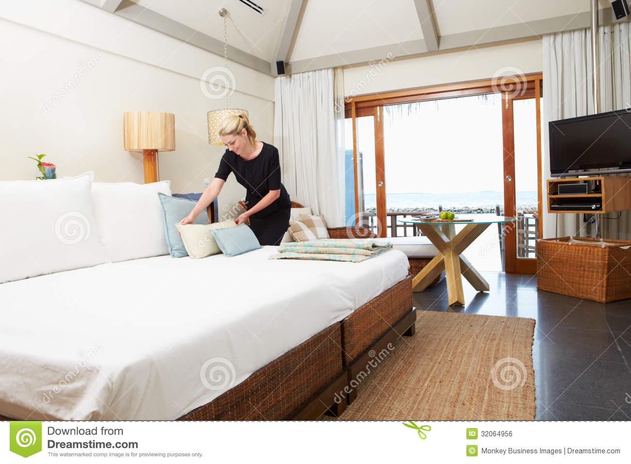 Hotel Chambermaid Making Guest Bed Stock Photo Image