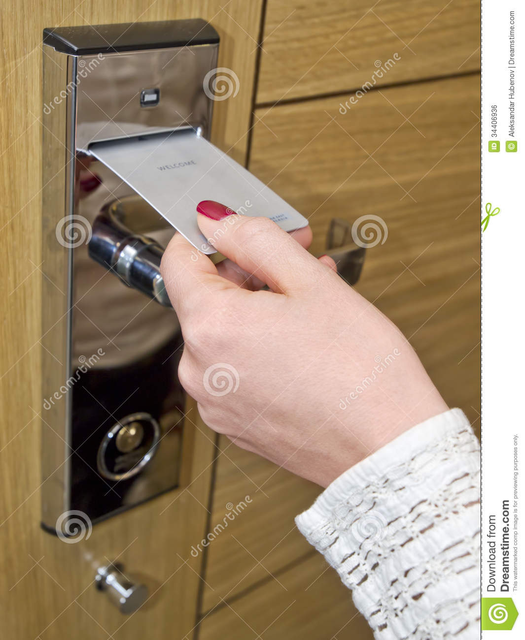 Hotel door - woman's hand inserting key card in an electronic lock.
