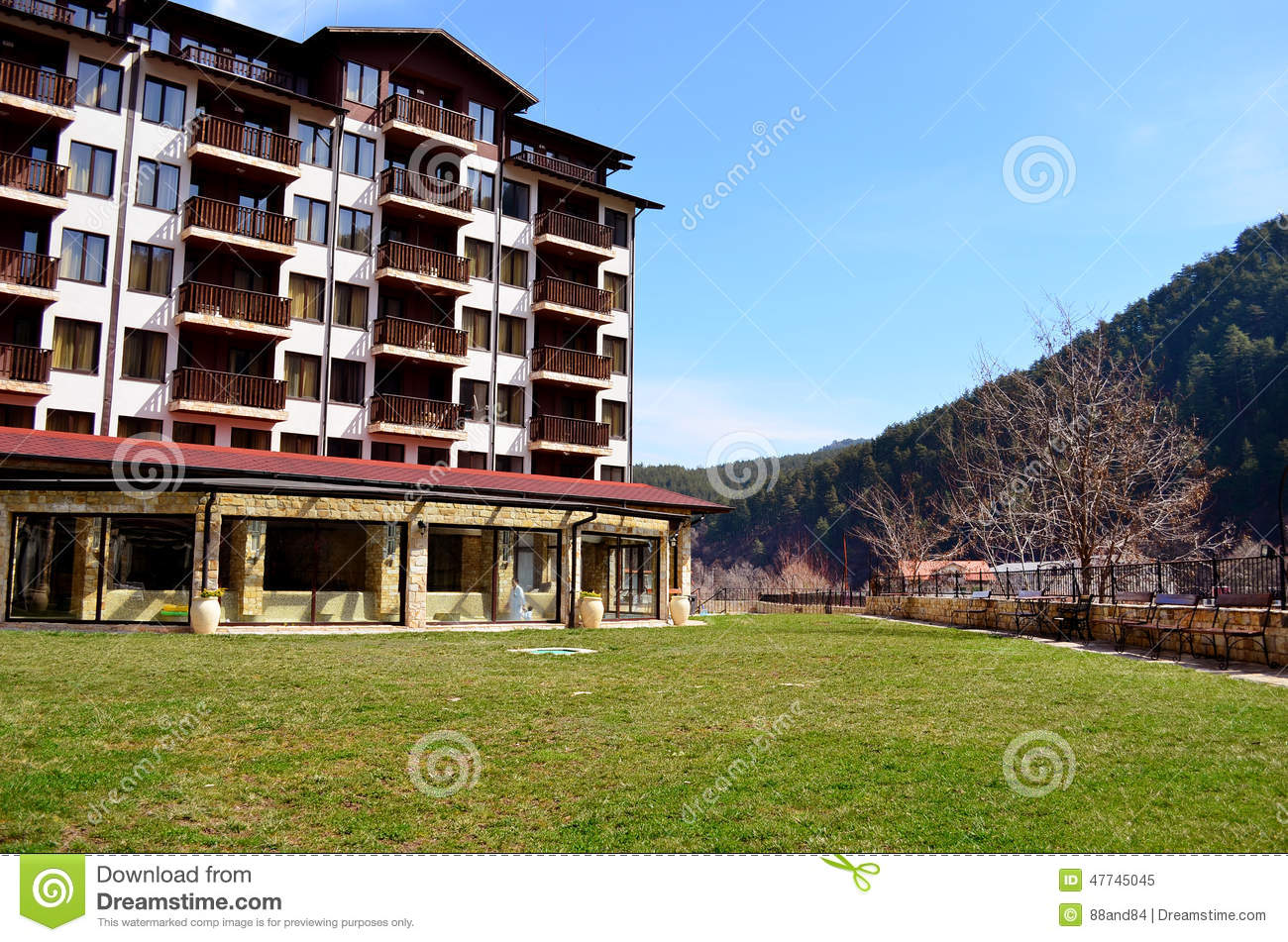 Hotel exterior mountain hotel with wooden balconies stock for Hotels with balconies