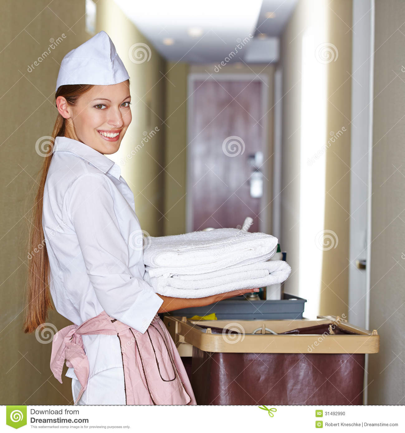 Hotel Maid Doing Housekeeping Stock Photo - Image: 31492990