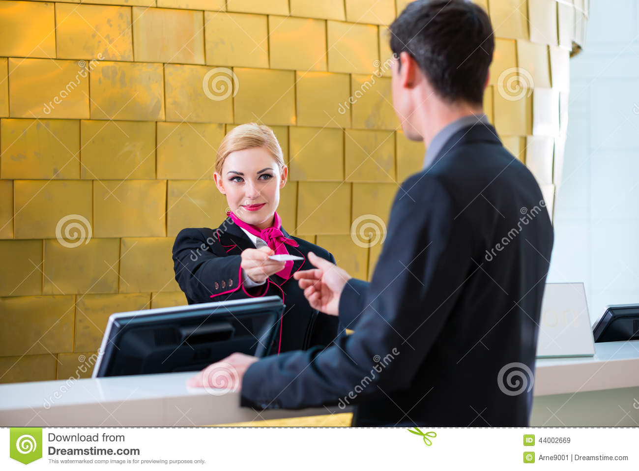 Hotel Receptionist Check In Man Giving Key Card Stock