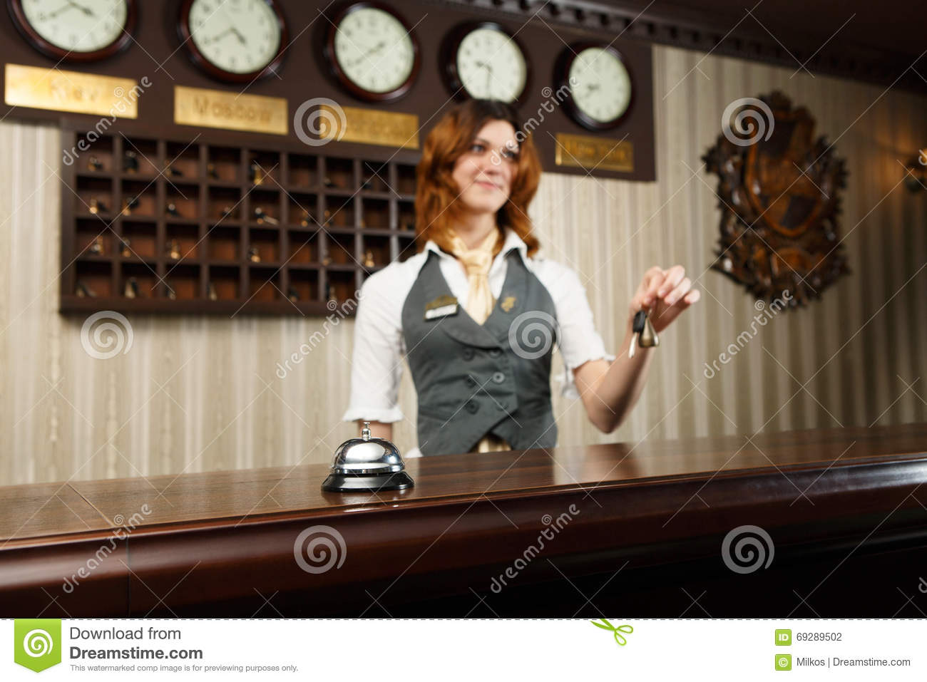 Hotel Receptionist And Counter Desk With Bell Stock Photo - Image ...
