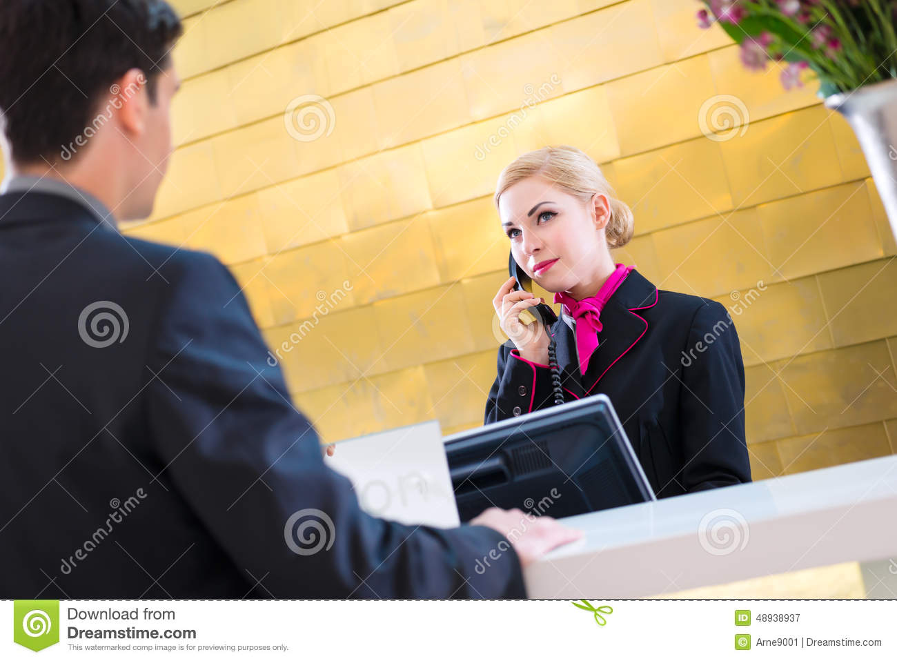 Hotel Receptionist With Phone And Guest Stock Photo ...
