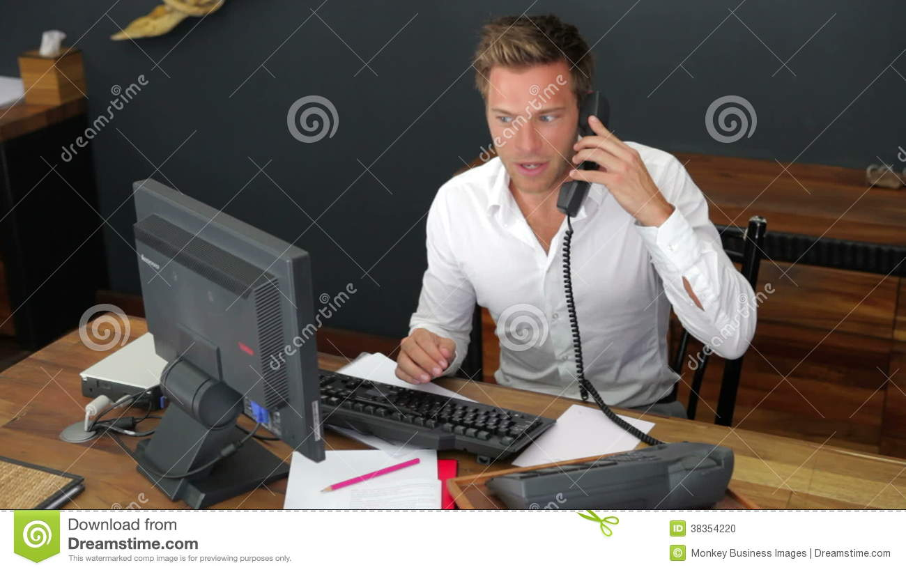 Hotel receptionist using computer and phone stock footage video hotel receptionist using computer and phone stock footage video 38354220 sciox Images