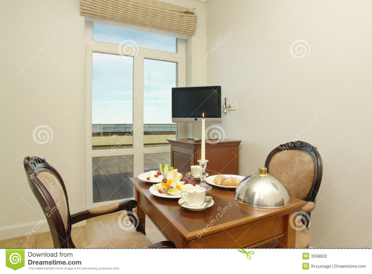 Hotel Dining Room With Table Set Cutlery And A Two Person Meal