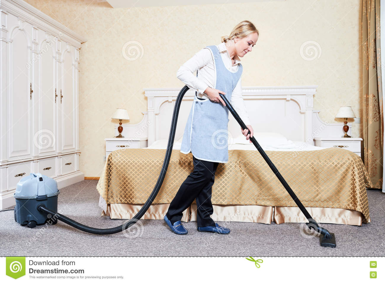 hotel service female housekeeping worker with vacuum cleaner stock