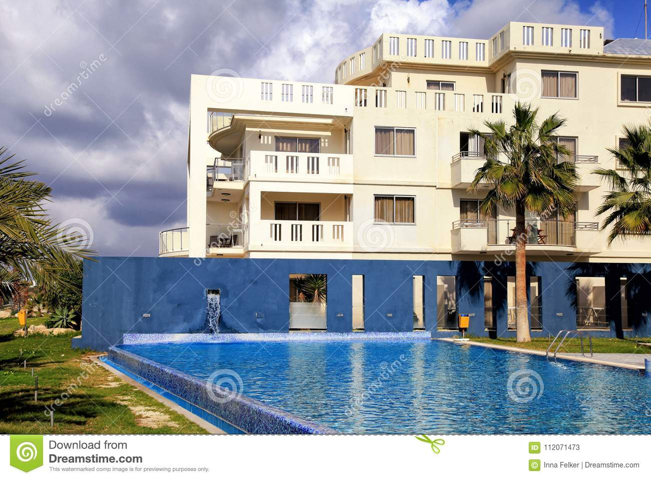 Hotel, swimming pool and palm trees, Cyprus.