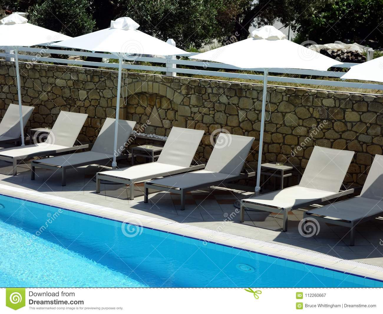 Hotel Swimming Pool, Sun Beds And Umbrellas Stock Image ...