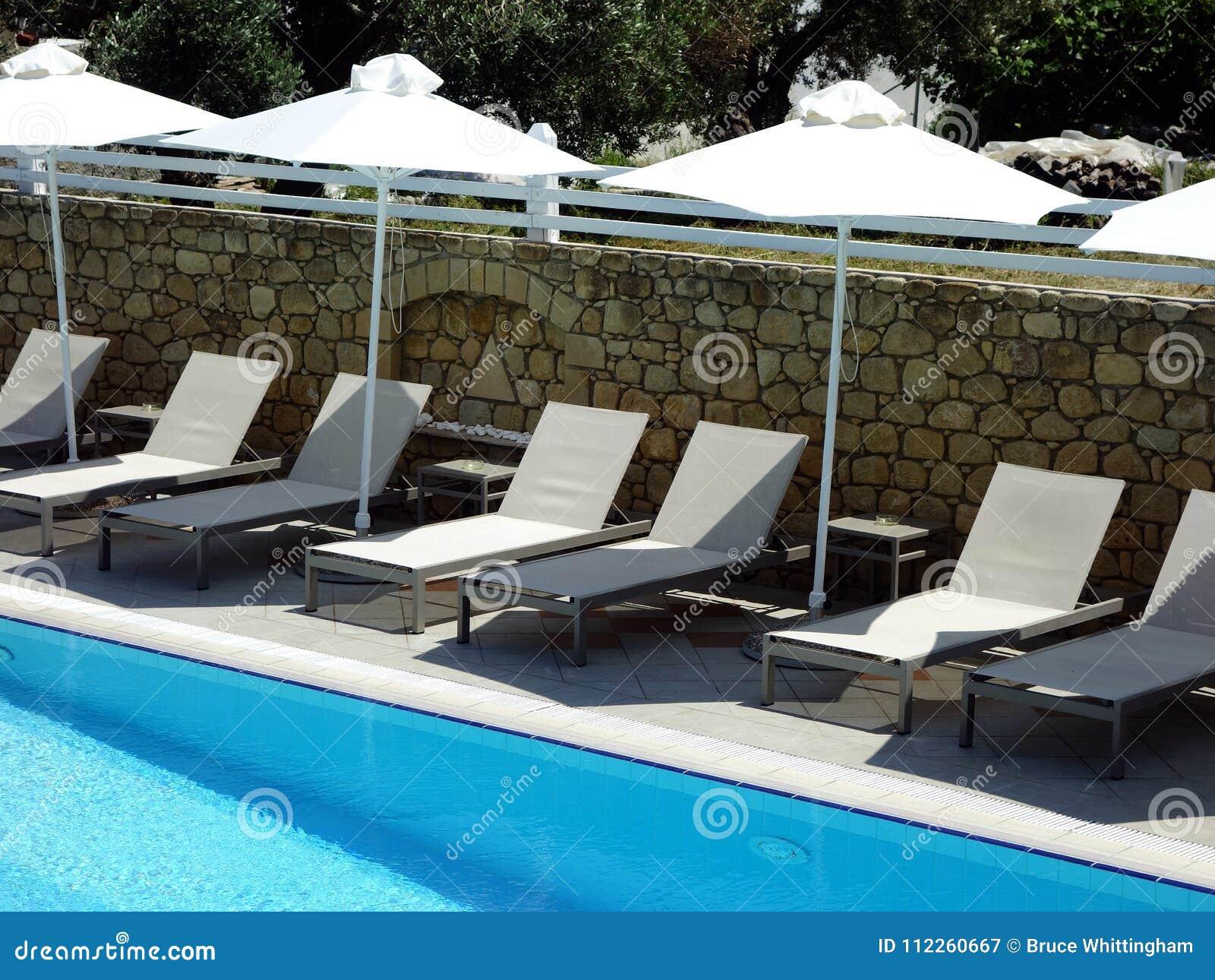 Hotel Swimming Pool Sun Beds And Umbrellas Stock Image Image Of Umbrellas Pool 112260667
