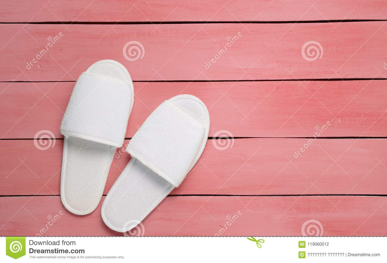 Hotel White Slippers On A Red Wooden Floor Top View Stock Photo