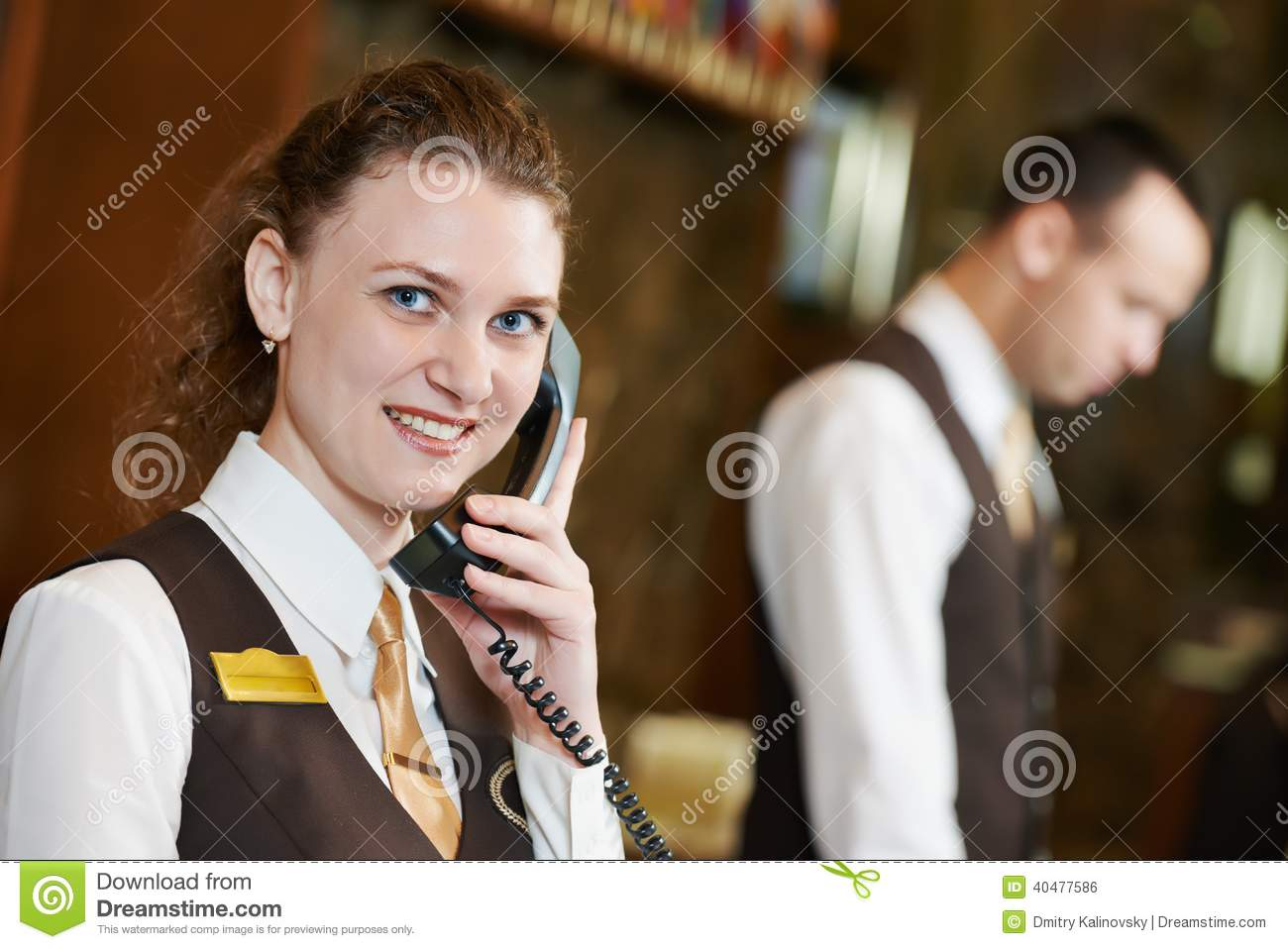 Hotel Worker With Phone On Reception Stock Photo - Image ...