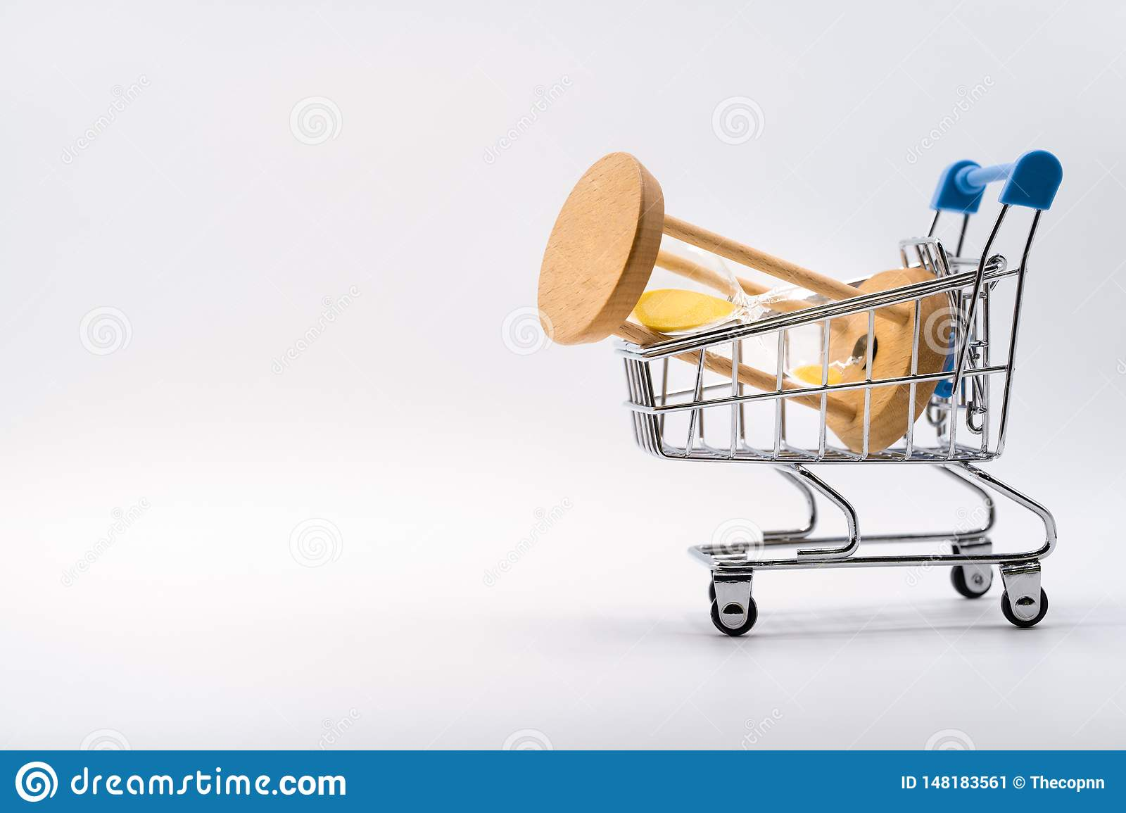 Hourglass in shopping cart on white background