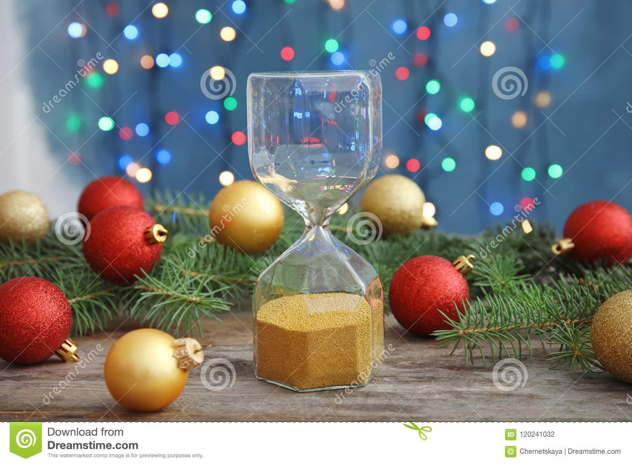 download hourglass and festive decor on table christmas countdown stock photo image of background