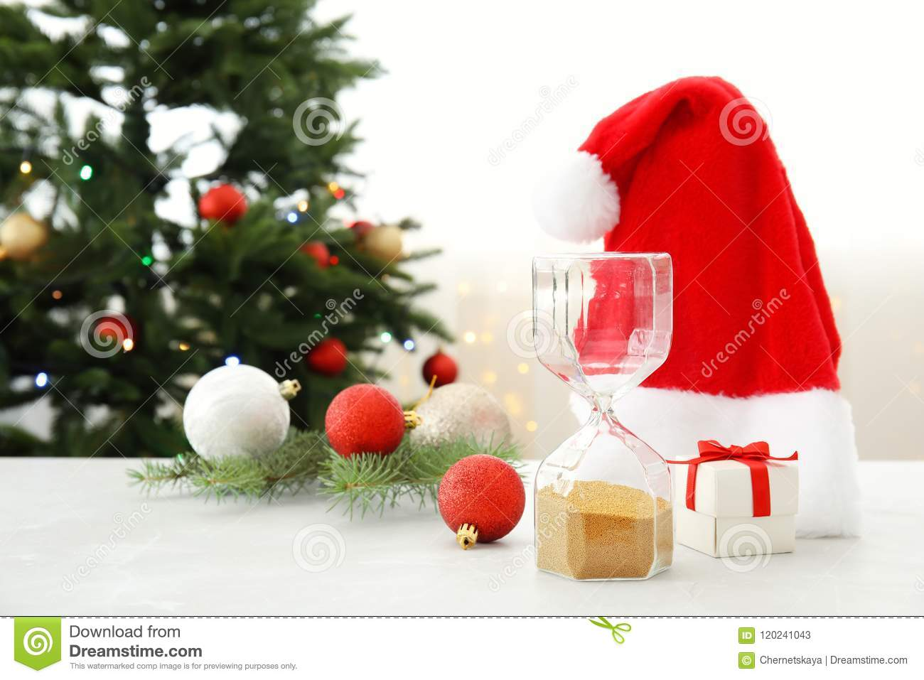 hourglass santa hat and decor on table christmas countdown