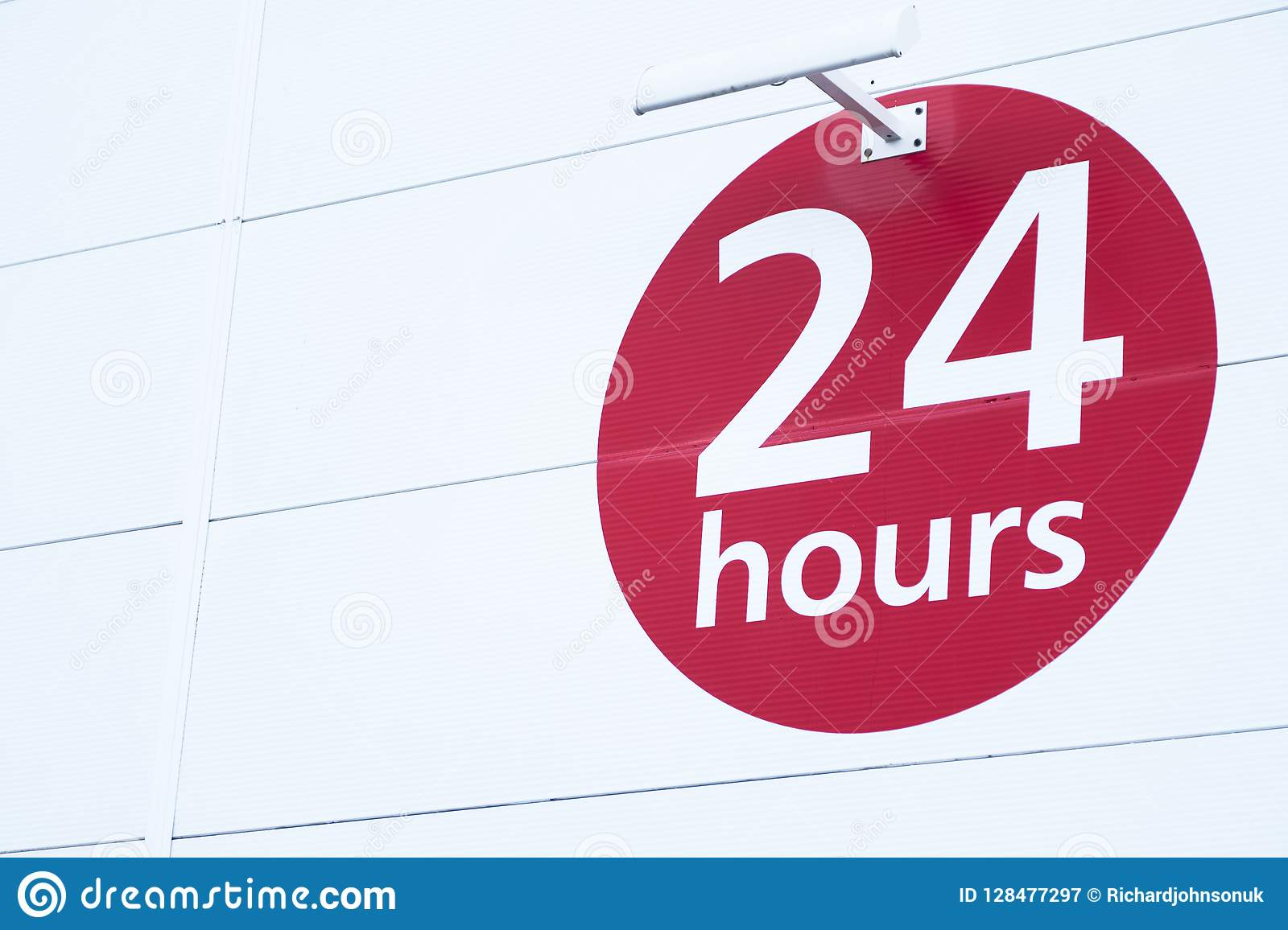 24 hours sign round red circle on white background for shop opening times
