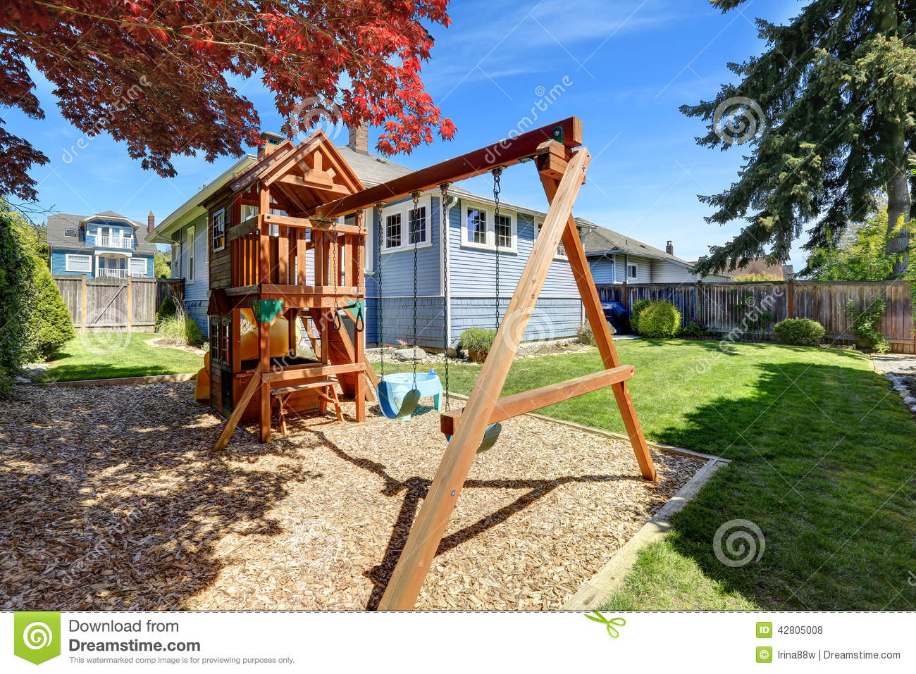 House Backyard With Playground For Kids Stock Photo