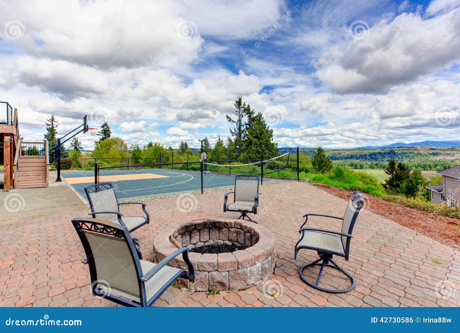 backyard patio area with basketball court stock photo image