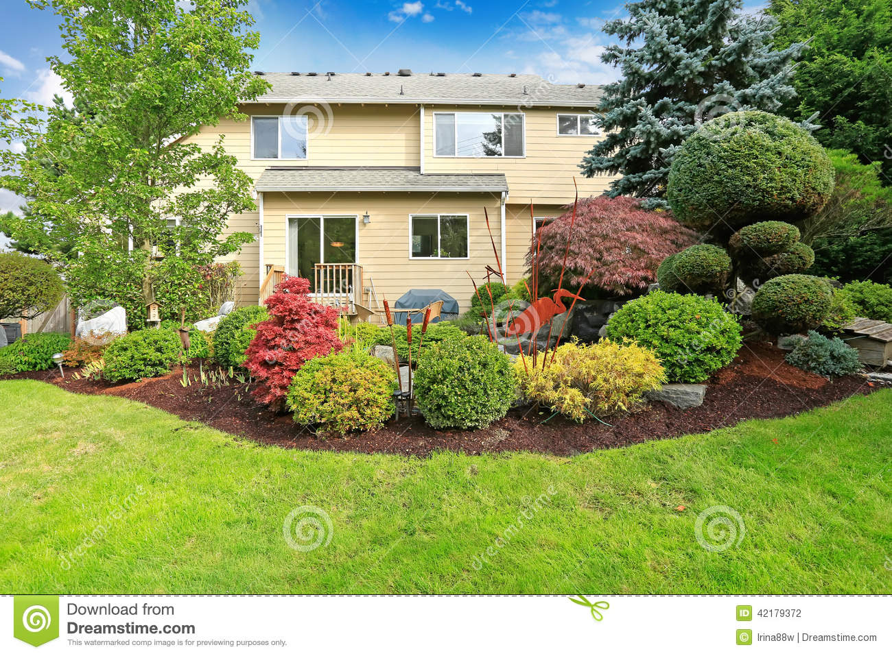 House with backyard tropical garden and lawn stock photo House backyard landscape