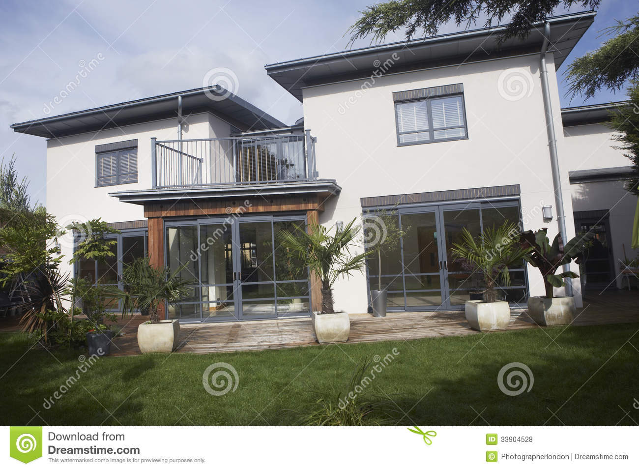 House With Balcony And Lawn Royalty Free Stock Photos
