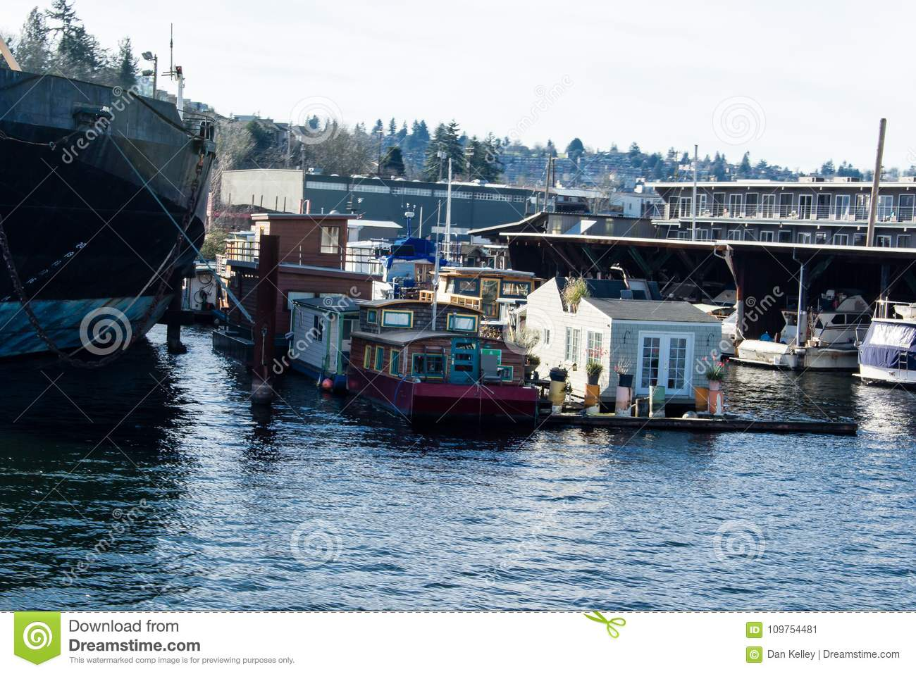 House Boats On Salmon Bay Across From Ballard Next To A Ship