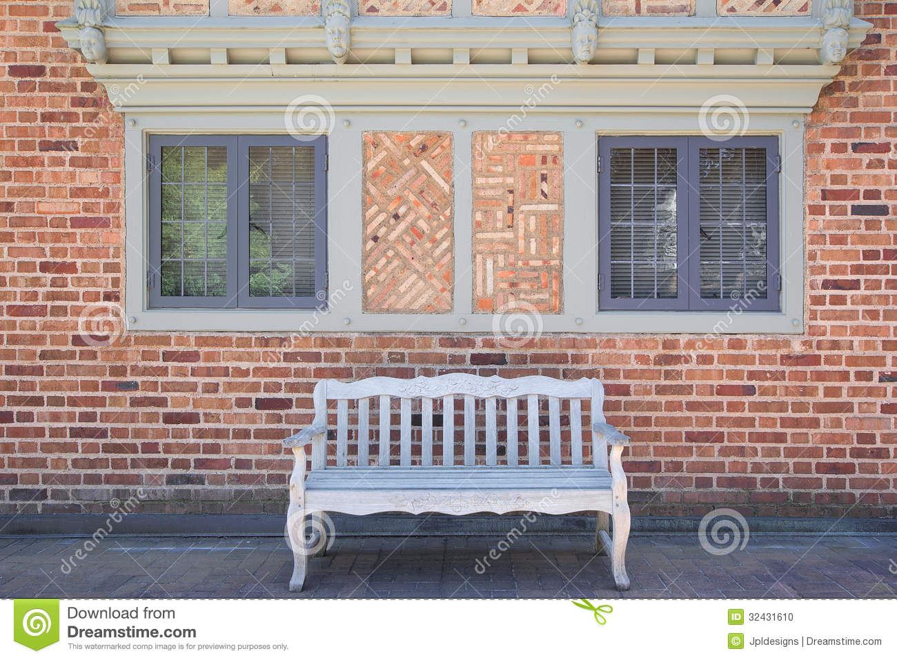 House brick exterior with wood bench stock photo image for Brick house exterior design