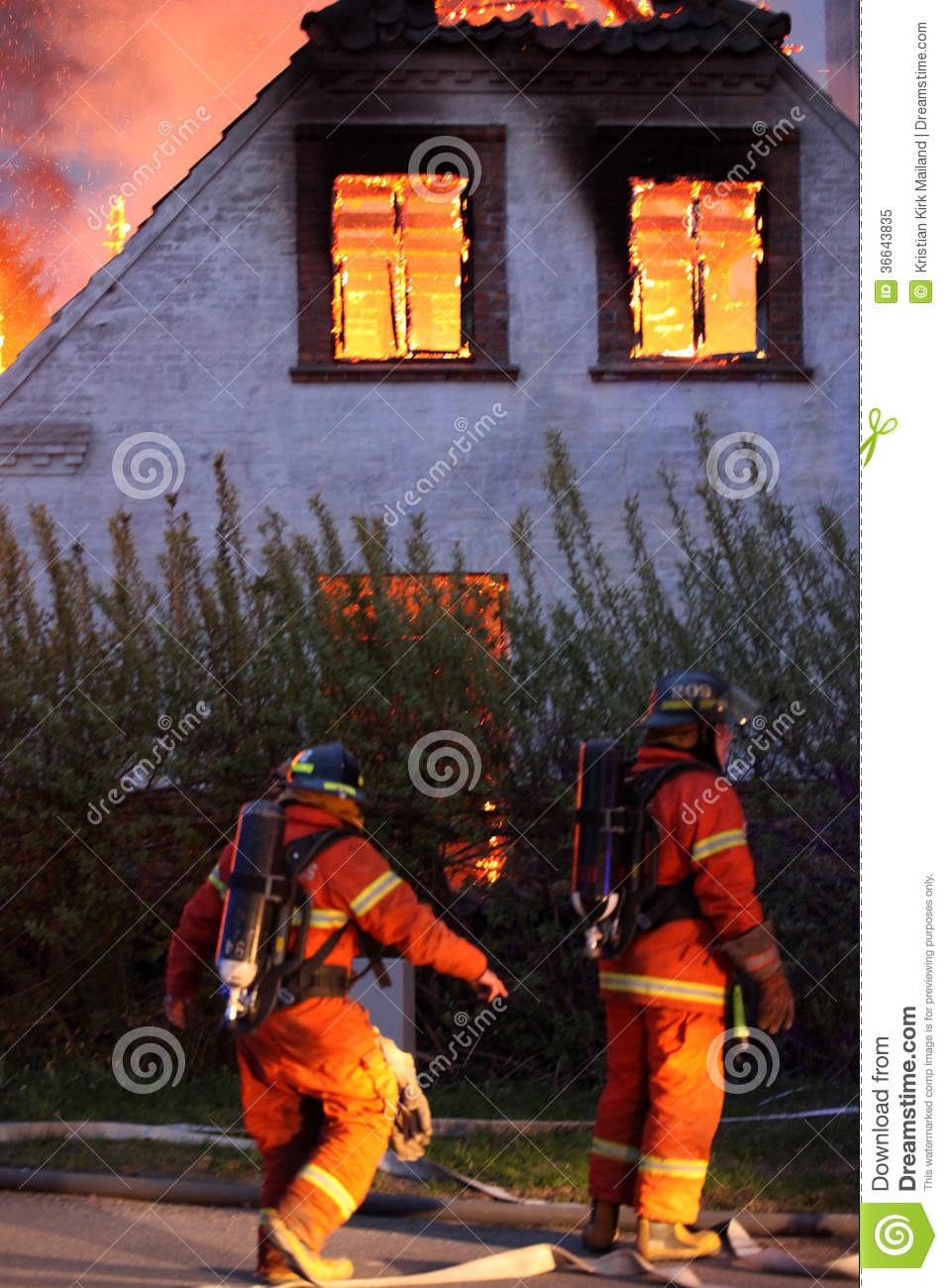 House burning and fire fighters
