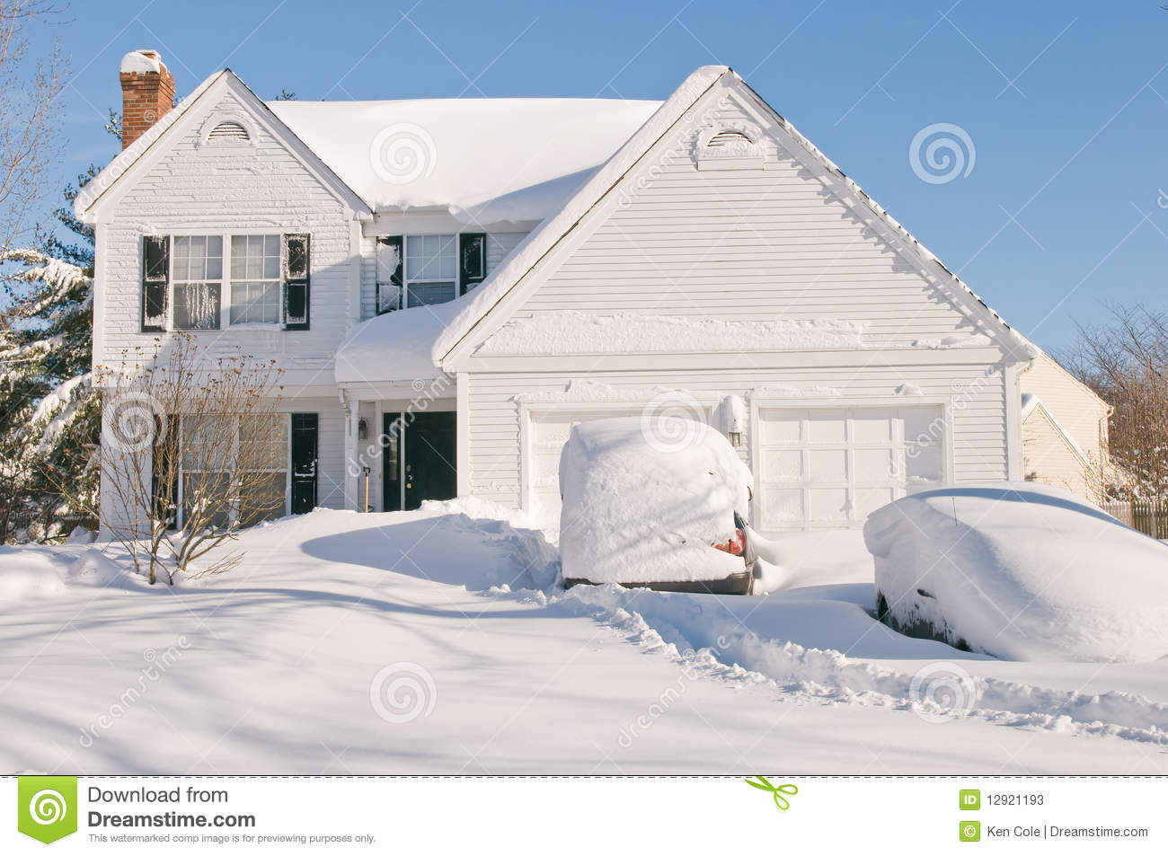 House and cars after snowstorm