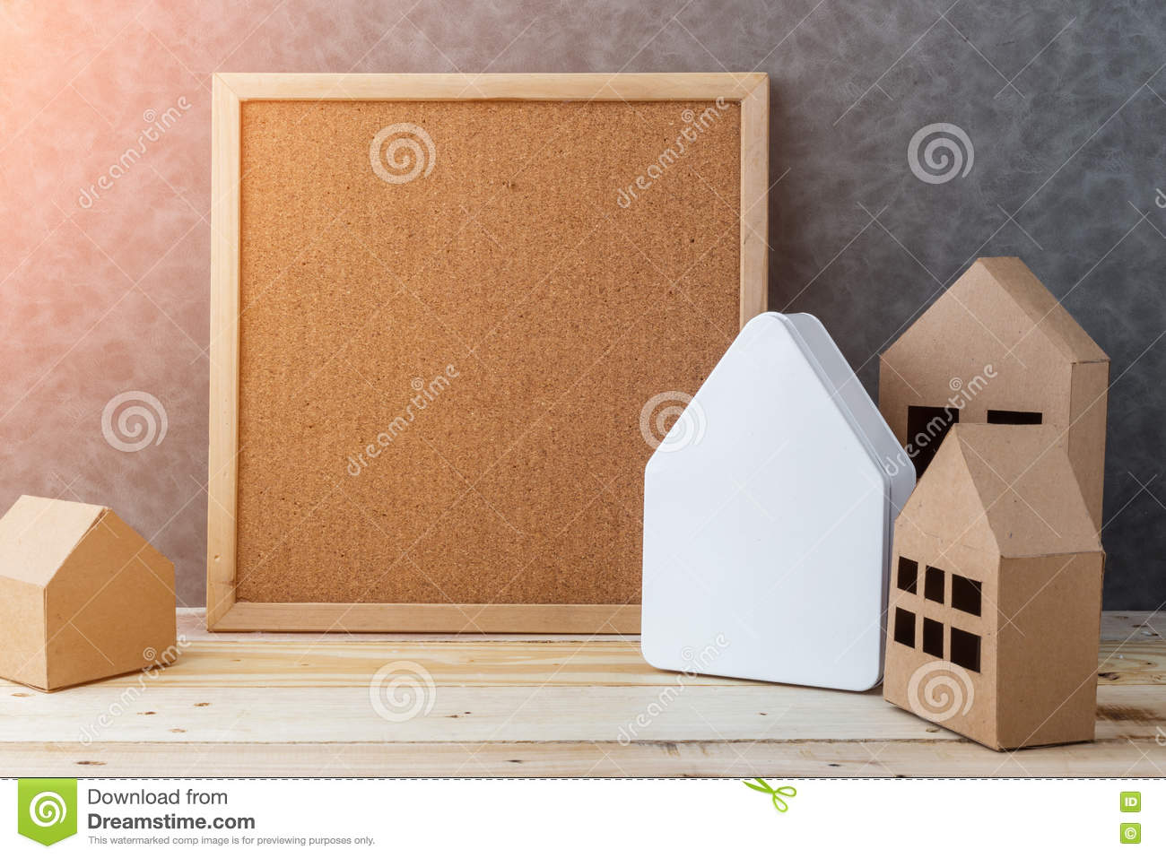 House Concept With House Shape Cardboard On Wooden Floor And