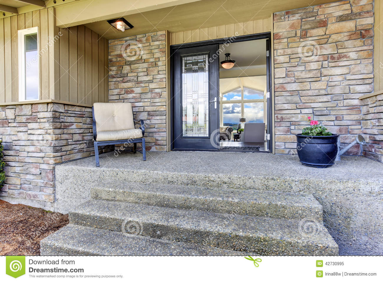 House Entrance Porch With Stone Wall Trim Stock Photo