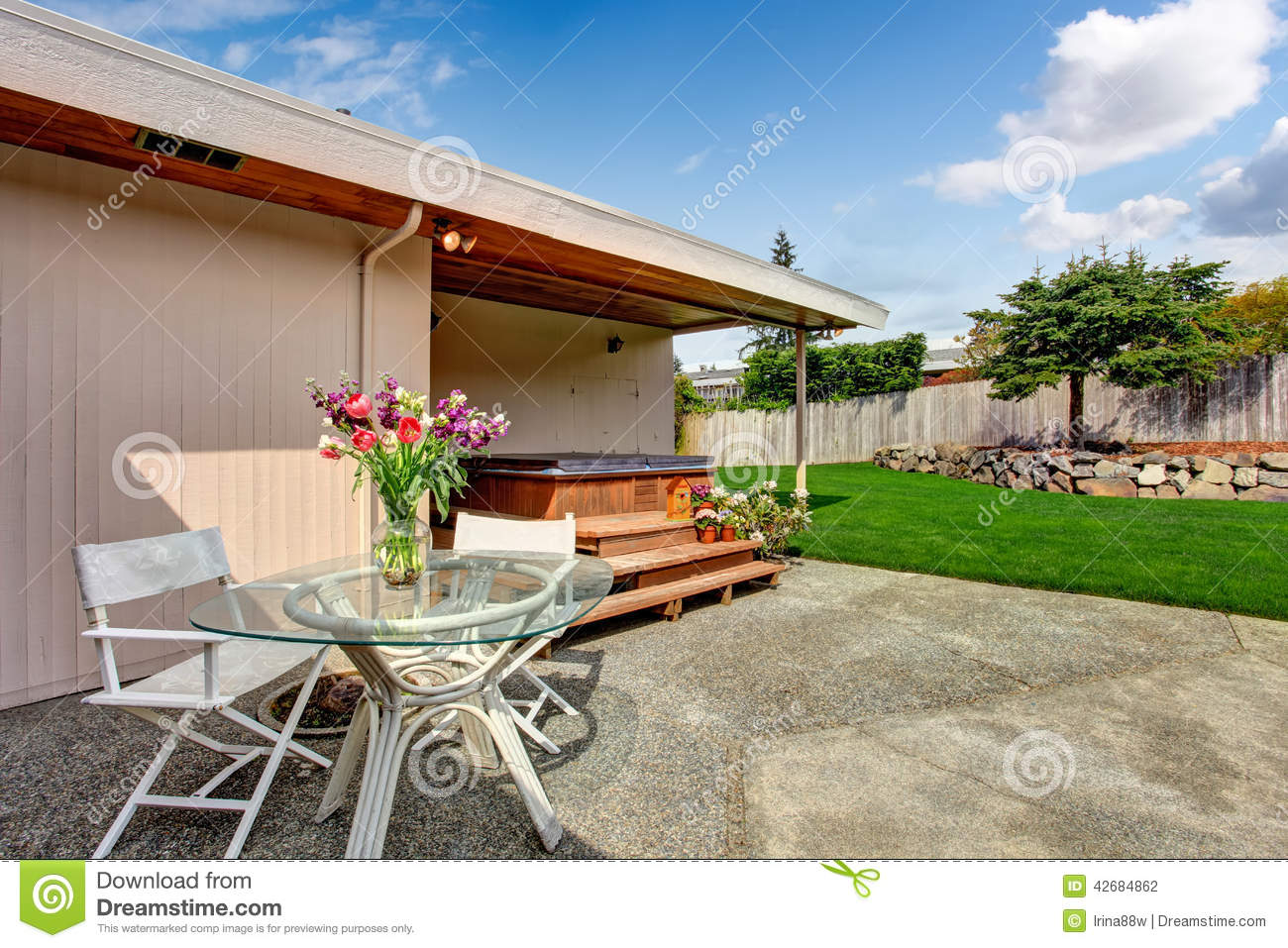 Best Backyard View :  Photo House exterior Backyard deck with glass top table and chairs