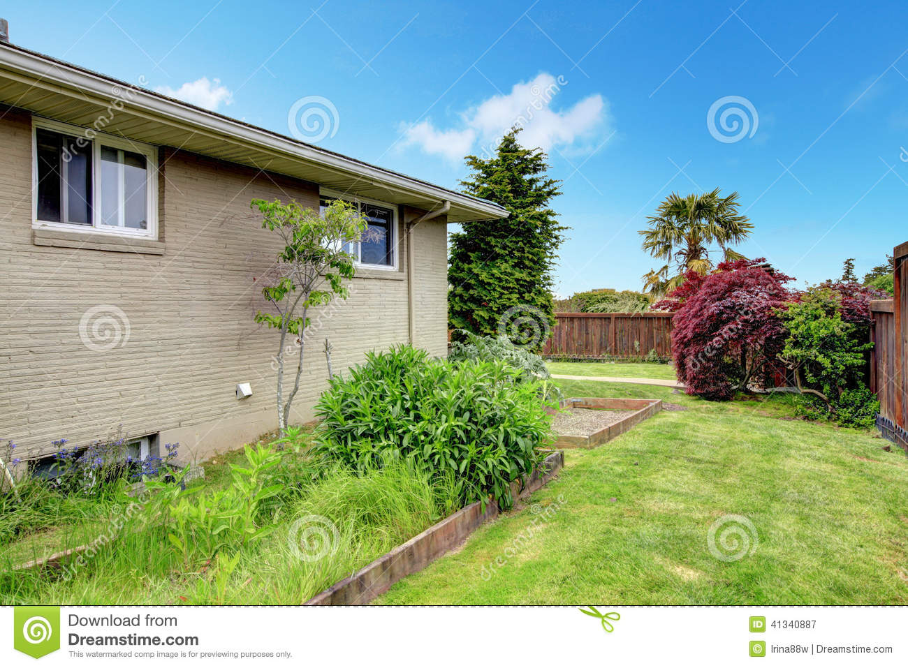 House exterior view of wall with flower bed royalty free for Exterior view of house