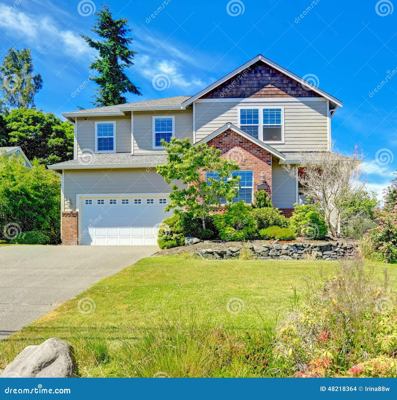 House Exterior With Brick Trim Stock Photo
