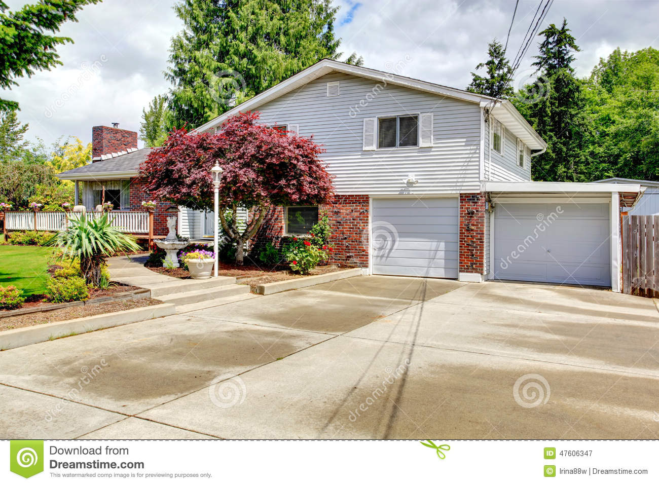 House exterior with brick wall trim stock photo image for Brick garages prices