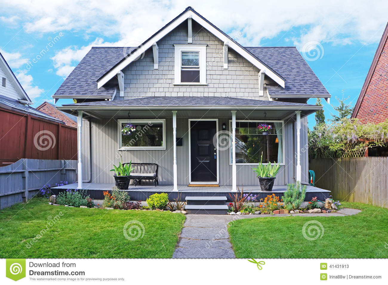 House exterior entrance porch and front yard view stock for Small flower beds front homes