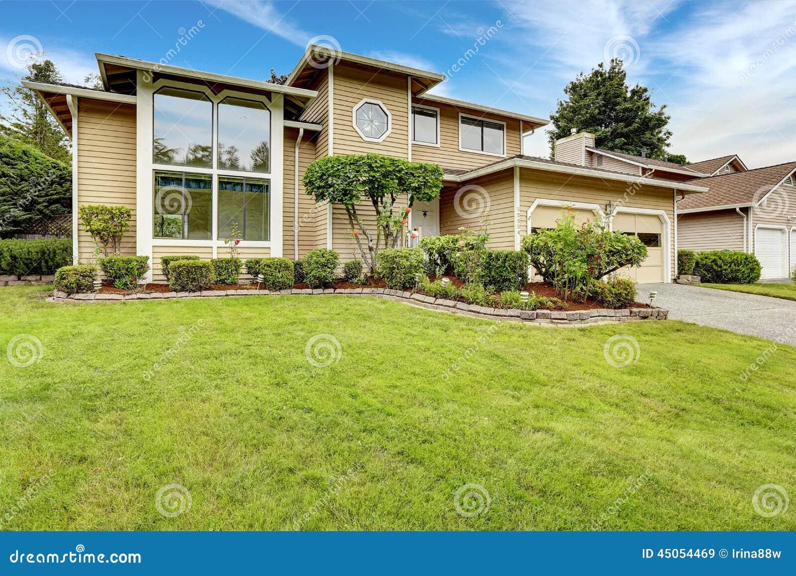 house exterior large window front yard landscape design clapboard siding beautiful flower bed 45054469