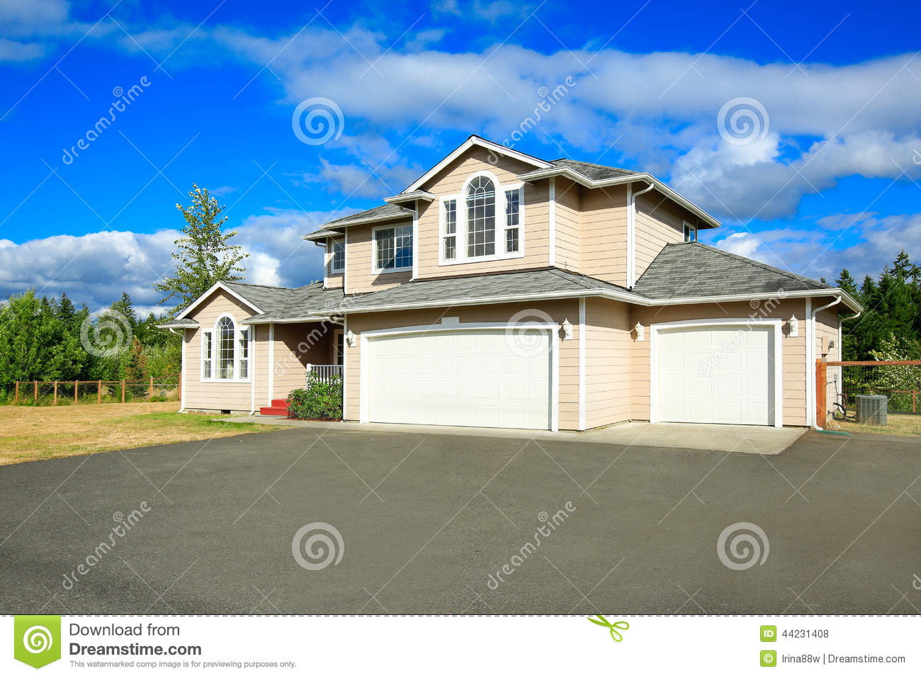 House Exterior With Two Car Garage And Driveway Stock