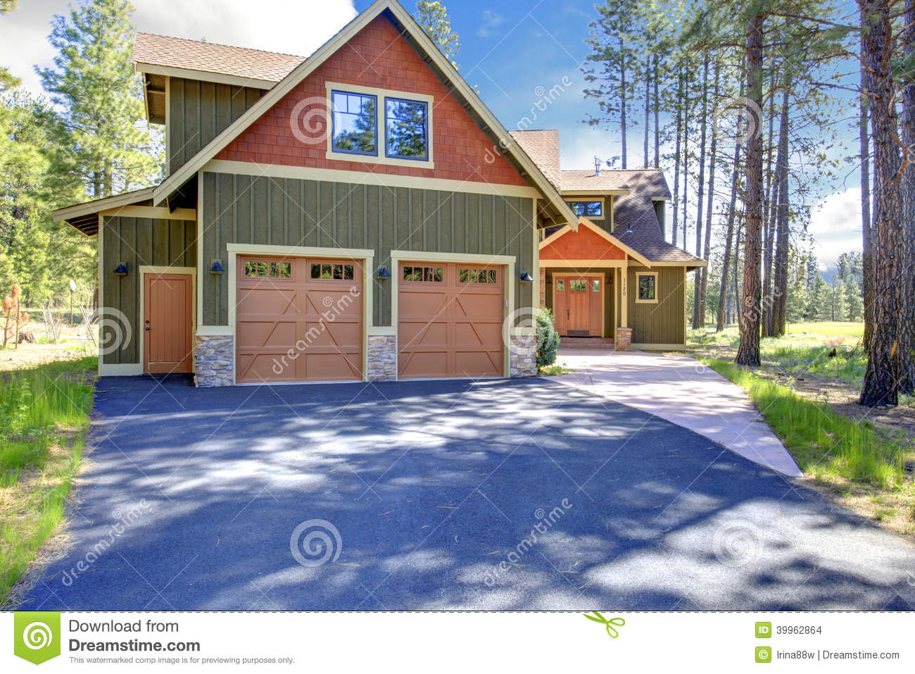 Exterior Garage large new luxury home exterior with orange and red driveway. stock