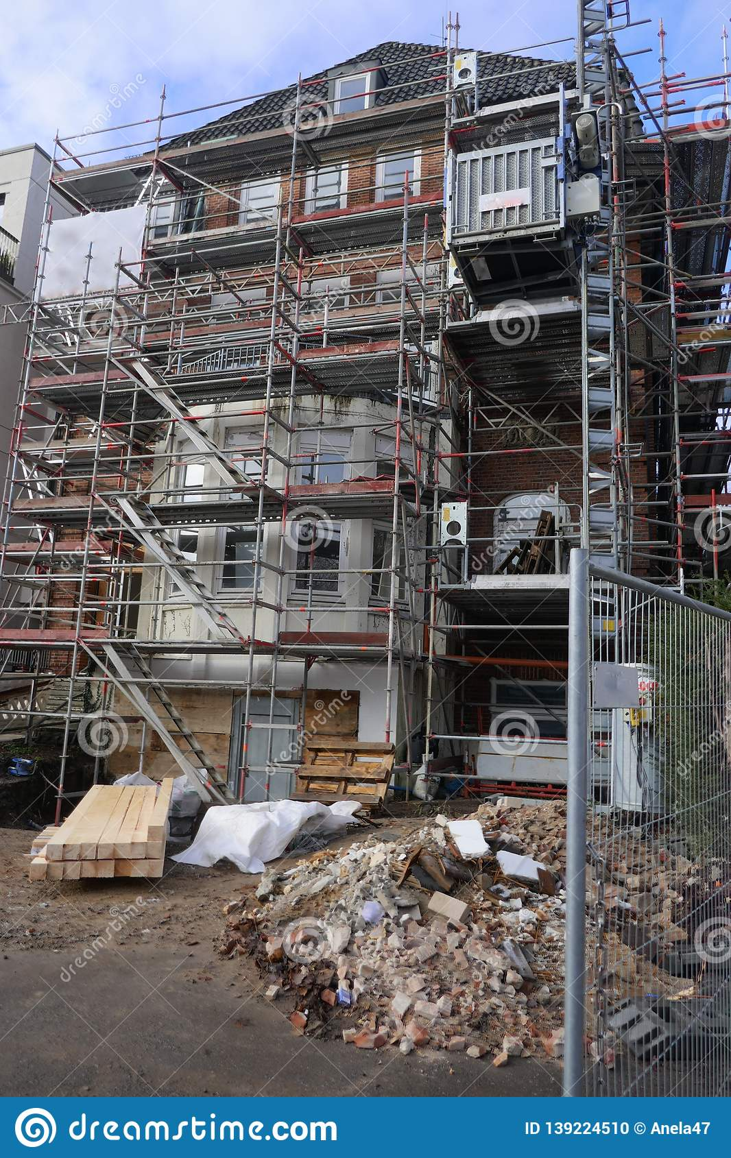 House facade with scaffolding, renovation and reconstruction of an old villa in Hamburg, Germany