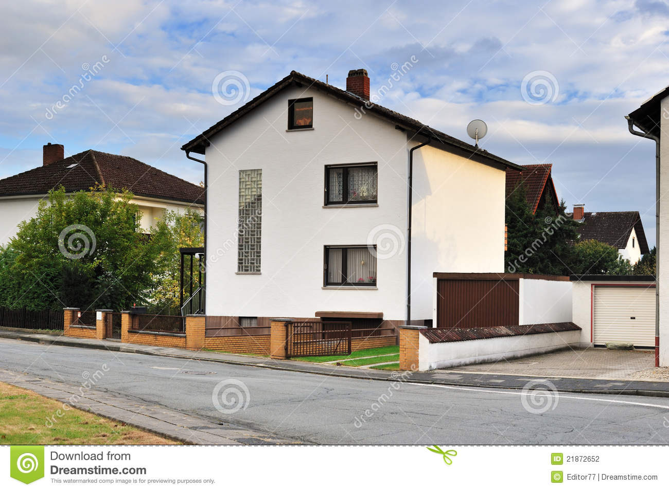House facade with small courtyard in front stock for Courtyard in front of house