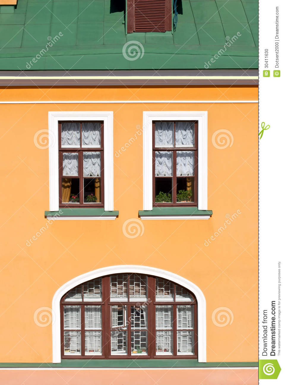 Business Design A House And Window: House Facade With Windows. Stock Photo