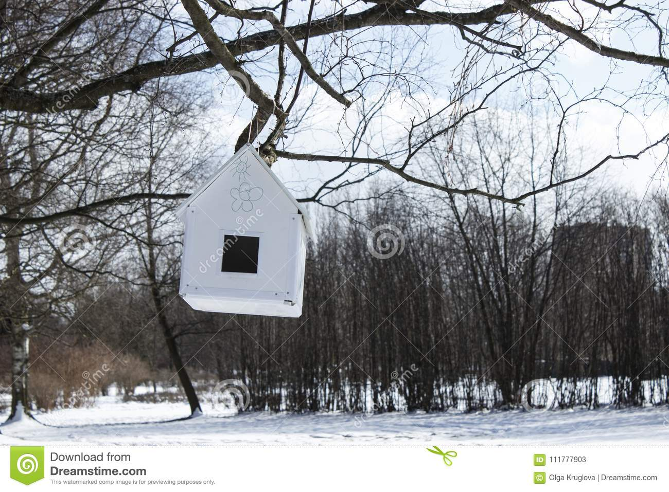 House-feeder hanging from a tre