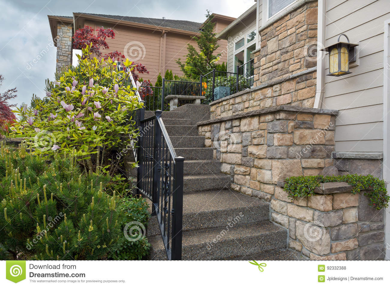 House Front Cultured Stone Work Siding And Stair Stock Photo